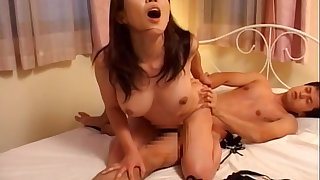 Fleshly lovemaking on the bed with a cute Japanese old hat modern