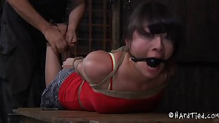 Alluring Asian slave tied showcasing her nice ass in BDSM