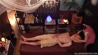 Before her client fucks her in all poses Asian masseur gives him a blowjob