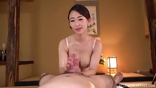 Handsome POV handjob with a busty Asian milf addicted to cock