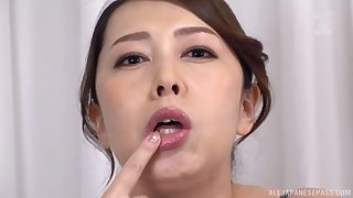 Kazama Yumi plays with long dildo regarding her mouth for the best fun